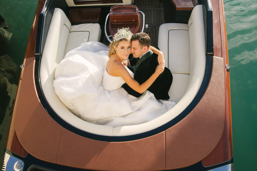 gorgeous couple portrait on luxury Riva boat at Fisher Island Club Wedding