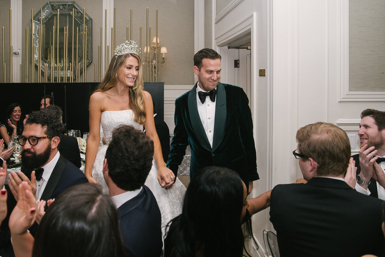 newlyweds entering Fisher Island Club Wedding dinner