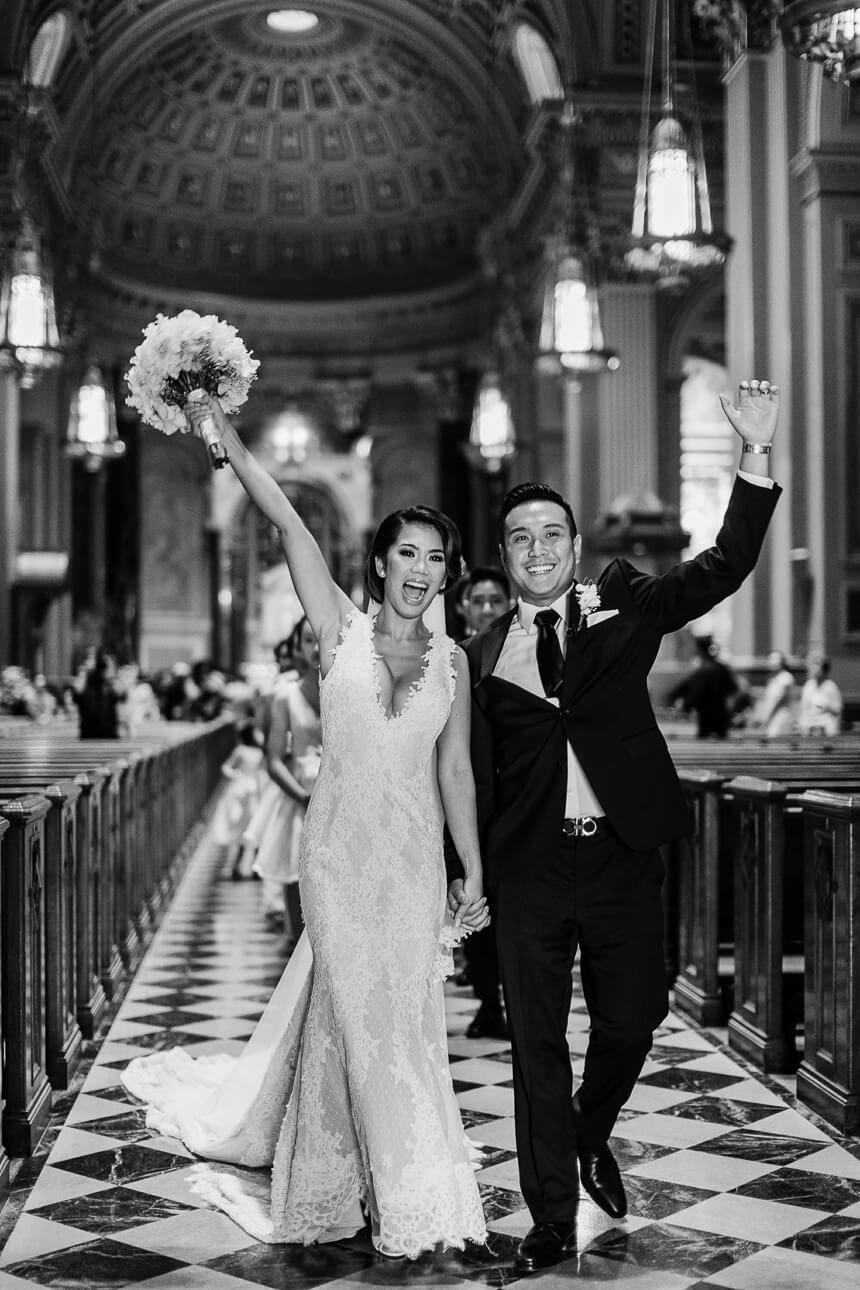 grand exit after the wedding ceremony at The Cathedral Basilica of Saints and Paul in Philadelphia